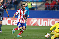 Atletico de Madrid´s Arda Turan and Olympiacos´s goalkeeper Roberto during Champions League soccer match between Atletico de Madrid and Olympiacos at Vicente Calderon stadium in Madrid, Spain. November 26, 2014. (ALTERPHOTOS/Victor Blanco) /NortePhoto