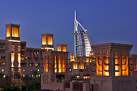 Dubai, United Arab Emirates. Al Qasr Hotel, villas and Burj al Arab Hotel.  Evening. .