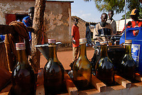 Mali Bamako, fuel station with fuel in bottles / MALI Bamako Tankstelle mit Benzin in Flaschen