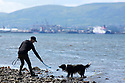 Dave (the dog) plays his owner Amanda Johnston near Rock Beach, Glen Road, County Down, Northern Ireland, Monday, June 10, 2019.  (Photo by Paul McErlane for Belfast Telegraph)