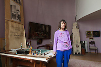 Moscow, Russia, 25/04/2013..Ekaterina Karinskaya inside the Melnikov House [1927-1929], the most famous construction by Soviet avant-garde architect Konstantin Melnikov, in central Moscow. The house, which is slowly collapsing, is the subject of a complex dispute between the architect's grand-daughter Ekaterina, who lives there and wants to turn it into a museum, her sister Elena, and businessman Sergei Gordeev.