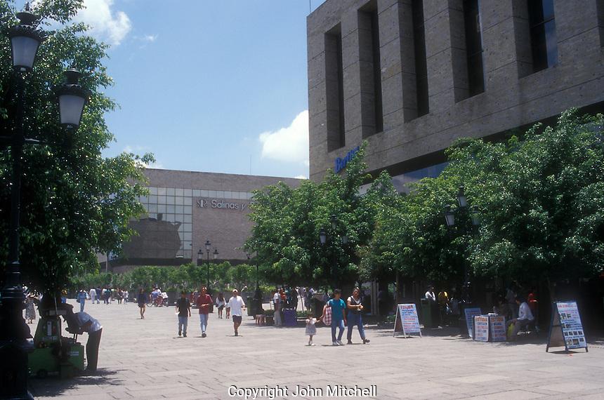 Pedestrians on the Plaza Tapatia in the city of Guadalajra, Mexico