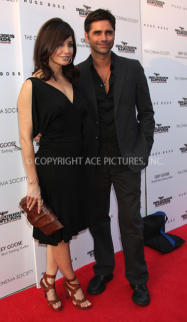 WWW.ACEPIXS.COM . . . . .  ....August 17 2009, New York City....Gina Gershon and John Stamos arriving at The Cinema Society & Hugo Boss screening of 'Inglourious Basterds' at the SVA Theater on August 17, 2009 in New York City.....Please byline: AJ SOKALNER - ACE PICTURES.... *** ***..Ace Pictures, Inc:  ..tel: (212) 243 8787 or (646) 769 0430..e-mail: info@acepixs.com..web: http://www.acepixs.com
