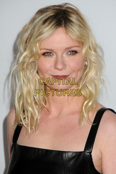 Kirsten Dunst.AFI Fest 2011 - Los Angeles Time Young Hollywood Panel held at Grauman's Chinese Theatre, Hollywood, California, USA..November 4th, 2011.headshot portrait black leather sleeveless  red lipstick wavy hair .CAP/ADM/BP.©Byron Purvis/AdMedia/Capital Pictures.