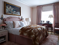 In the pink master bedroom, the upholstered headboard and bedside table are custom made and the bedding is by Des Jours des Nuits. The 19th-century chair and 18th-century desk in front of the window are Italian and the 17th-century painting above the bed is by Guido Cagnacci.
