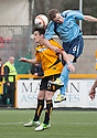 Forfar's Gavin Malin gets above Alloa's Kevin Cawley.