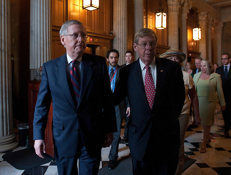 UNITED STATES - AUGUST 4: Senate Minority Leader Mitch McConnell, R-Ky., left, and Sen. Johnny Isakson, R-Ga., arrive for the Senate Republicans' news conference on Democrats' tax hikes on Wednesday, Aug. 4, 2010. (Photo By Bill Clark/Roll Call via Getty Images)