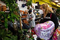 NEW YORK, NY - MAY 10: A woman wearing a face mask enters the Garden Center in Jackson Heights on Mother's Day on May 10, 2020 in Queens, New York. COVID-19 has spread to most countries in the world, claiming more than 283,000 lives and more than 4.1 million people infected, Queens has been one of the places most affected by the Coronavirus. (Photo by Pablo Monsalve / VIEWpress via Getty Images)