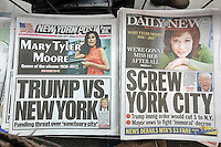 "New York newspapers on Thursday, January 26, 2017 report on President Donald Trump's executive order on immigration and its effect on ""sanctuary cities"".  In addition the top of each paper reports on the death of Mary Tyler Moore. (© Richard B. Levine)"