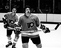 Philadelphia Flyers #8 Dave Schultz, & #5 Larry Goodenough. ( 1975 photo/Ron Riesterer)