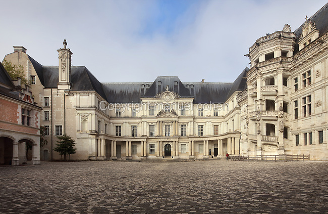 Gaston d'Orleans wing, 17th century, designed by Francois Mansart, 1598-1666, seen from the courtyard of the Chateau Royal de Blois, built 13th - 17th century in Blois in the Loire Valley, Loir-et-Cher, Centre, France. On the right is the South East facade of the Francois I wing, built 16th century in Italian Renaissance style, with its monumental spiral staircase. The chateau has 564 rooms and 75 staircases and is listed as a historic monument and UNESCO World Heritage Site. Picture by Manuel Cohen