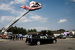 July 3, 2008. Washington, NC.. The funeral of Spc. Joel A. Taylor, assigned to the 1st Squadron, 3rd Armored Cavalry Regiment, Fort Hood, Texas; died June 25 in Mosul, Iraq, of wounds sustained when his vehicle encountered an improvised explosive device on June 24, 2008. He was 20.. Members of the local fire and police departments line the route to the family cemetery, 14 miles from the funeral home, as Spc. Taylor's casket is driven through town.