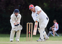 L French in batting action for Noak Hill as M Gooch looks on from behind the stumps - Hornchurch Athletic CC 3rd XI vs Noak Hill Taverners CC - Lords International Essex Cricket League at Hylands Park - 27/06/09- MANDATORY CREDIT: Gavin Ellis/TGSPHOTO - Self billing applies where appropriate - 0845 094 6026 - contact@tgsphoto.co.uk - NO UNPAID USE.