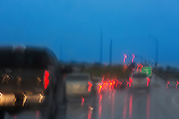 Rainy evening drive-time rush hour traffic congestion on Mopac in Austin, Texas.