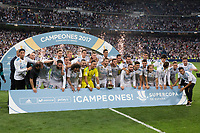 Real Madrid team group with the trophy of Super Cup of Spain