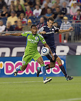 Seattle Sounders FC defender James Riley (7) and New England Revolution midfielder Marko Perovic (29) battle for a pass. The New England Revolution defeated the Seattle Sounders FC, 3-1, at Gillette Stadium on September 4, 2010.
