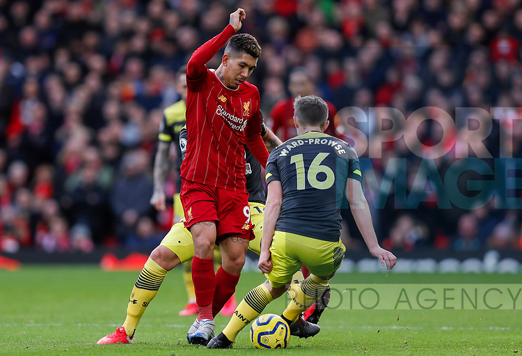 Roberto Firmino of Liverpool is tackled by James Ward-Prowse of Southampton during the Premier League match at Anfield, Liverpool. Picture date: 1st February 2020. Picture credit should read: James Wilson/Sportimage