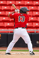 Tomas Telis #13 of the Hickory Crawdads at bat against the Greensboro Grasshoppers at L.P. Frans Stadium on May 18, 2011 in Hickory, North Carolina.   Photo by Brian Westerholt / Four Seam Images