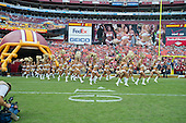 Washington Redskins cheerleaders run on to the field prior to the game against the Detroit Lions at FedEx Field in Landover, Maryland on Sunday, September 22, 2013.<br /> Credit: Ron Sachs / CNP