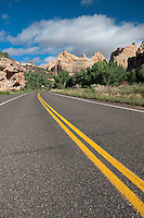 731350253 the scenic drive through capitol reef with the capitol dome formation in the background in capitol reef national park utah united states
