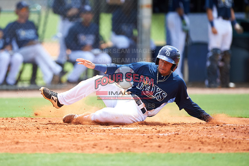 GCL Rays shortstop Luis Leon (1) slides home safely during the first game of a doubleheader against the GCL Twins on July 18, 2017 at Charlotte Sports Park in Port Charlotte, Florida.  GCL Twins defeated the GCL Rays 11-5 in a continuation of a game that was suspended on July 17th at CenturyLink Sports Complex in Fort Myers, Florida due to inclement weather.  (Mike Janes/Four Seam Images)