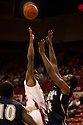 01 December 2010: Nebraska guard Caleb Walker (25) puts up two from the paint against Jackson State's Oliver Jefferson (24) at the Devaney Sports Center in Lincoln, Nebraska. Nebraska defeated Jackson State 76 to 57.
