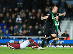 West Ham's Enner Valencia tussles with Stoke's Charlie Adam who protests his innocence<br /> <br /> Barclays Premier League - West Ham United v Stoke City - Upton Park - England -12th December 2015 - Picture David Klein/Sportimage