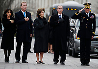 From right, former President George W. Bush, second from right, former first lady Laura Bush, Neil Bush and Sharon Bush, stand as the flag-draped casket of former President George H.W. Bush is carried by a joint services military honor guard from the U.S. Capitol, Wednesday, Dec. 5, 2018, in Washington. <br /> Credit: Alex Brandon / Pool via CNP / MediaPunch