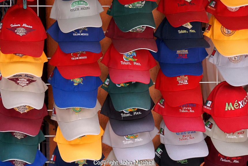 Colorful tourist baseball caps for sale in Tulum, Riviera Maya, Mexico