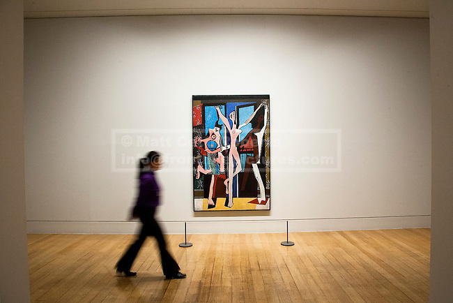 13/02/2012. LONDON, UK. A member of gallery staff walks past Pablo Picasso's 'The Three Dancers' at a Tate Britain exhibition exploring the artist's lifelong connections with Britain. The exhibition, called 'Picasso and Modern British Art', starts at the Tate Britain on the 15th of February 2012. Photo credit: Matt Cetti-Roberts
