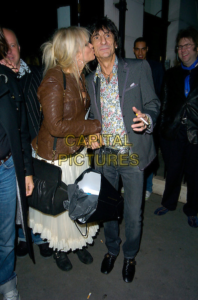 JO WOOD & RONNIE WOOD.Attending Ronnie Wood's Josephine Private View .at Scream Gallery, Bruton Street, London, England, .29th March 2007..full length kissing cheek married husband wife grey pinstripe suit jacket jeans floral patterned shirt smoking cigarette.CAP/CAN.©Can Nguyen/Capital Pictures