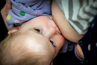 "A close-up of a baby breastfeeding.<br /> <br /> Image from the ""We Do It In Public"" documentary photography project collection: <br />  www.breastfeedinginpublic.co.uk<br /> <br /> Dorset, England, UK<br /> 17/04/2013"