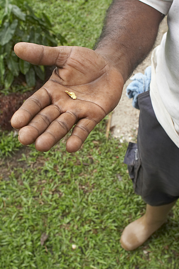 A Guyanese miner displays a gold nugget mined from the Brokopondo region of Suriname.  Hundreds of unregulated small mines operate in the region and are blamed for mercury pollution in the Brokopondo reservoir, a large man-made lake on which several Maroon communities rely for food and water.