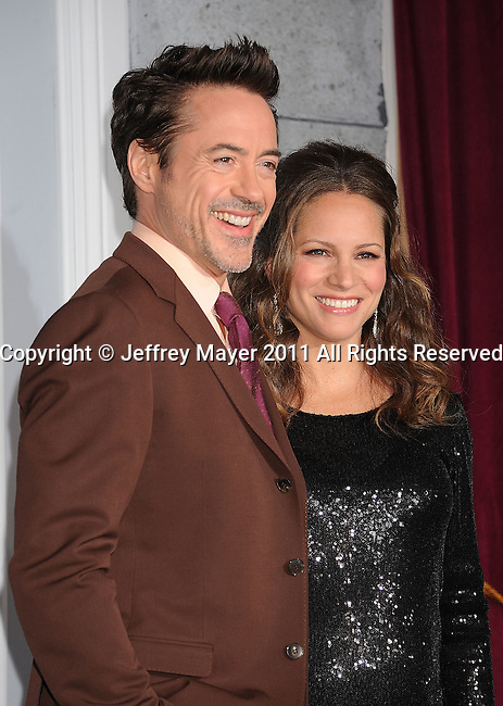 WESTWOOD, CA - DECEMBER 06: Actor Robert Downey Jr. and Susan Downey attends the Los Angeles premiere of 'Sherlock Holmes: A Game Of Shadows' at Regency Village Theatre on December 6, 2011 in Westwood, California.