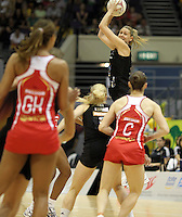 09.07.2011 Silver Ferns Casey Williams in action during the netball match between Silver Ferns and England at the Mission Foods World Netball Championship 2011 held at the Singapore Indoor Stadium in Singapore . Mandatory Photo Credit ©Michael Bradley.