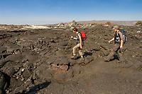 hikers on lava field in Hawaii Volcanoes National Park, Kilauea, Big Island, Hawaii, USA
