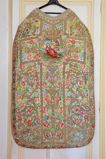 Embroidered chasuble, an outer liturgical vestment, of St Agnes of Jesus, or St Agnes of Langeac, 1602-34, in the Monastere Sainte Catherine de Sienne, or Monastery of St Catherine of Siena, founded 1623 by St Agnes of Jesus, in Langeac, Haute Loire, France. The design features Jesus praying on the Mount of Olives within a large cross. Picture by Manuel Cohen