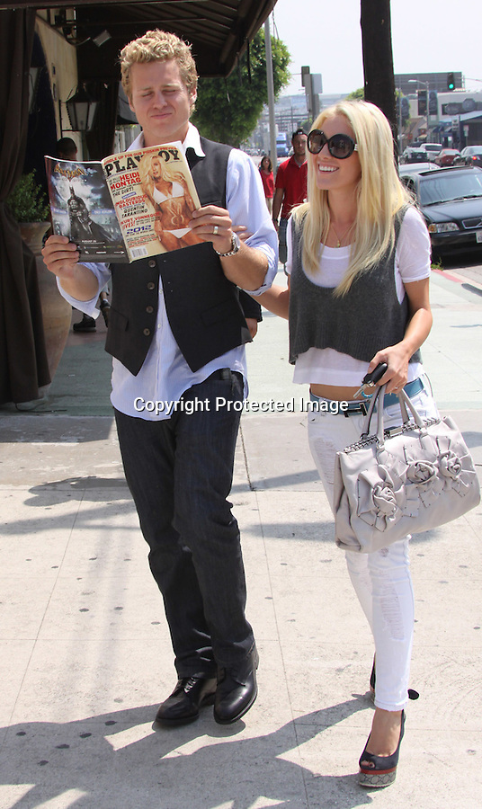 8-13-09...Heidi Montag & spencer Pratt showing off the new PlayBoy Magazine with Heidi on the cover. The couple was Filming an episode of the Hills at a restaurant in Los Angeles ...AbilityFilms@yahoo.com.805-427-3519.www.AbilityFilms.com