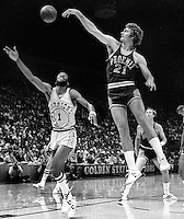 Phoenix Suns Dennis Awtrey blocks shot of Golden State Warrior Gus Williams during playoff game 1976.<br />(photo by Ron Riesterer)