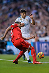 Marco Asensio of Real Madrid (R) fights for the ball with Gabriel Mercado of Sevilla FC (L) during La Liga 2017-18 match between Real Madrid and Sevilla FC at Santiago Bernabeu Stadium on 09 December 2017 in Madrid, Spain. Photo by Diego Souto / Power Sport Images