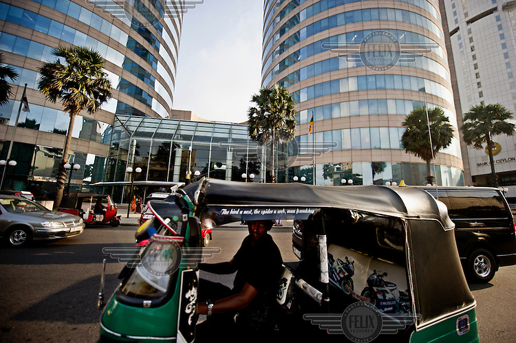 A tuk tuk infront of the World Trade Centre.