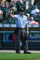 Umpire Ben May signals one more warmup pitch in between innings during the first game of a doubleheader between the Buffalo Bisons Rochester Red Wings on July 6, 2014 at Frontier Field in Rochester, New  York.  Rochester defeated Buffalo 6-1.  (Mike Janes/Four Seam Images)