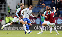 Cardiff City's Lee Peltier under pressure from Burnley's Jeff Hendrick (left) and Jack Cork<br /> <br /> Photographer Rich Linley/CameraSport<br /> <br /> The Premier League - Saturday 13th April 2019 - Burnley v Cardiff City - Turf Moor - Burnley<br /> <br /> World Copyright © 2019 CameraSport. All rights reserved. 43 Linden Ave. Countesthorpe. Leicester. England. LE8 5PG - Tel: +44 (0) 116 277 4147 - admin@camerasport.com - www.camerasport.com