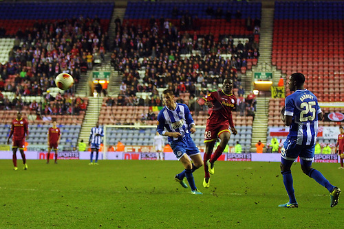 28.11.2013  Wigan, England. Junior Malanda of SV Zulte Waregem (BEL) curles the ball into the net and scores the winner during the Europa League game between Wigan v SV Zulte Waregem from The DW Stadium.