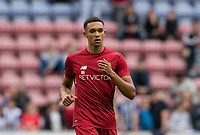 Trent Alexander-Arnold of Liverpool warms up ahead of the pre season friendly match between Wigan Athletic and Liverpool at the DW Stadium, Wigan, England on 14 July 2017. Photo by Andy Rowland.