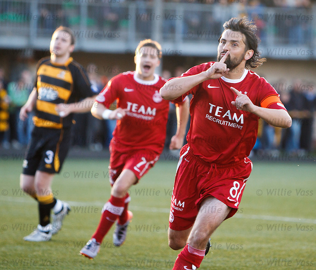 Paul Hartley scores from the penalty spot and celebrates to the Alloa fans with his finger to his mouth