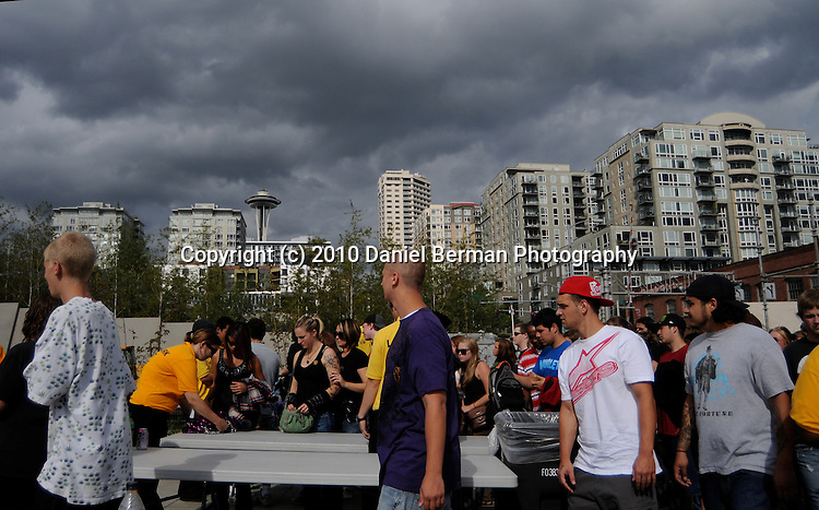 Seattle Hempfest - August 21-22, 2010 in Myrtle Edwards Park. Attendees enter through the crowded south entrance, under stormy skies. Photo by Seattle photographer Daniel Berman