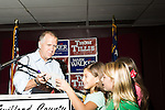 September 20, 2014. Greensboro, North Carolina.<br />  Thom Tillis signed an autograph for 10 year old Sarah Lilly Picarelli after the rally.<br />  Thom Tillis and Mark Walker hosted a rally at the Guilford County Republican Party headquarters for their supporters in the upcoming November election. Tillis, the current Speaker of the House for the NC House of Representatives, is running to take Democrat Kay Hagan's US Senate seat, while Walker, a local pastor, is running for the NC 6th District' s US Congressional seat.