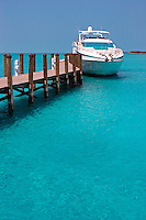 Dock leading out into the ocean on Sampson Cay, Exuma Islands, Bahamas