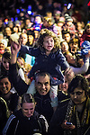 © Joel Goodman - 07973 332324 . 17 November 2013 . Oldham , UK . The crowd in front of the stage . The Christmas lights are turned on in Oldham Town Centre . Photo credit : Joel Goodman